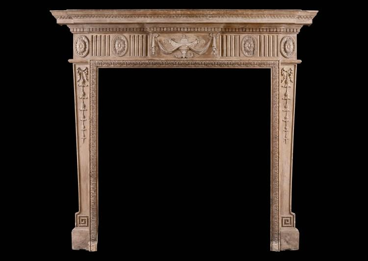 A Neo-Classical pine fireplace with carved urn
