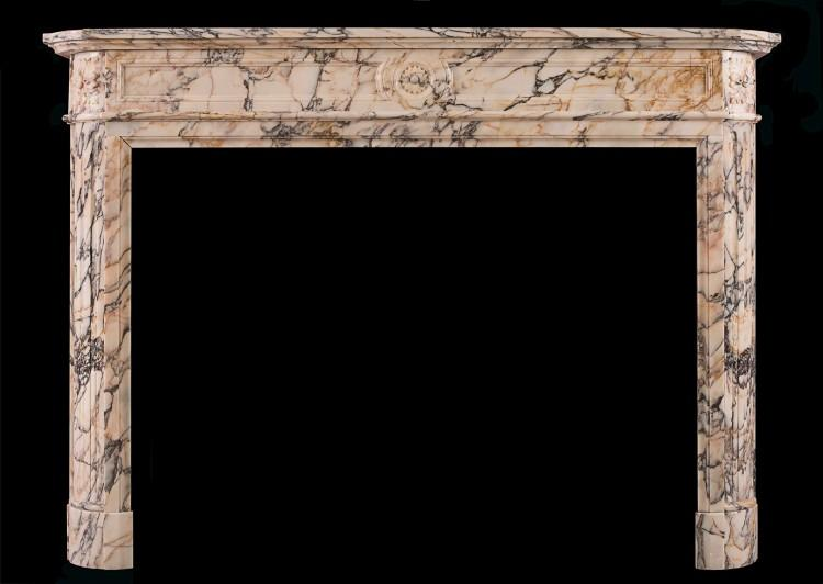 A Louis XVI style French fireplace in Breche Violette marble