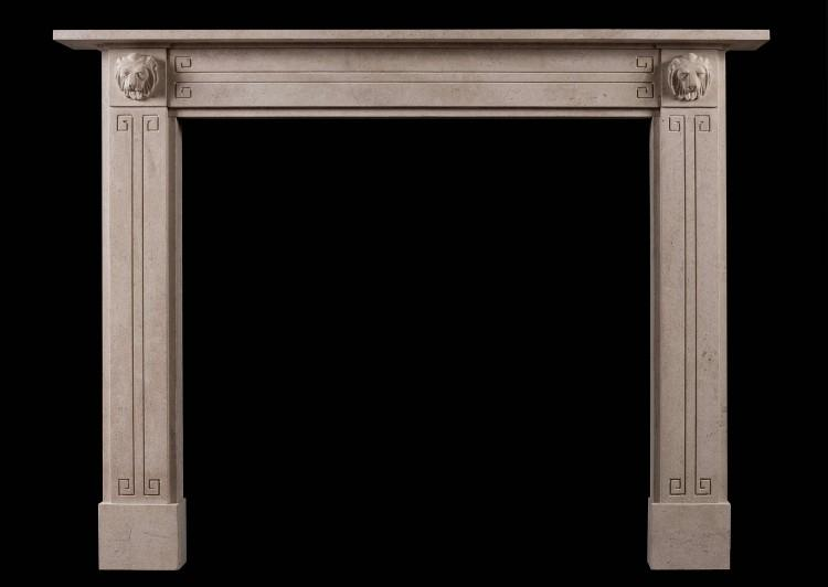 A Regency style Bath stone fireplace with carved lion's masks