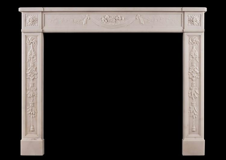 A finely carved French Louis XVI antique fireplace