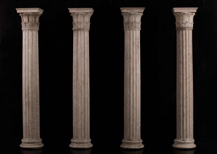 A collection of four neo-classical columns in Istrian stone
