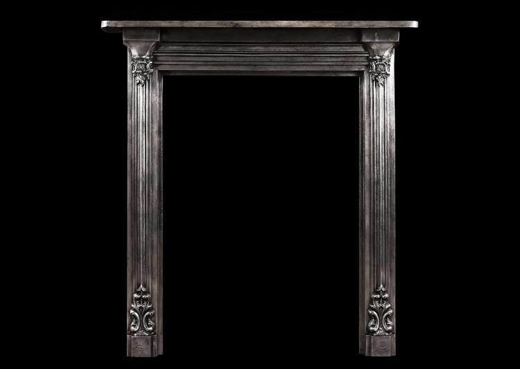 A polished cast iron fireplace