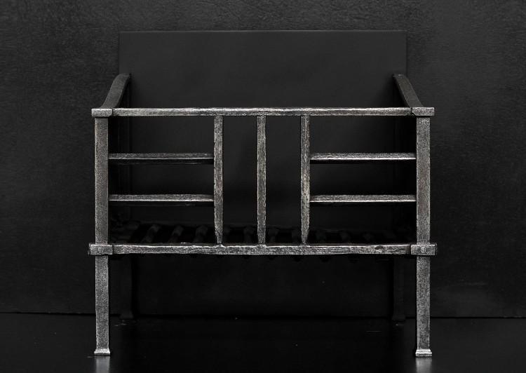 A small polished steel Art Deco firebasket