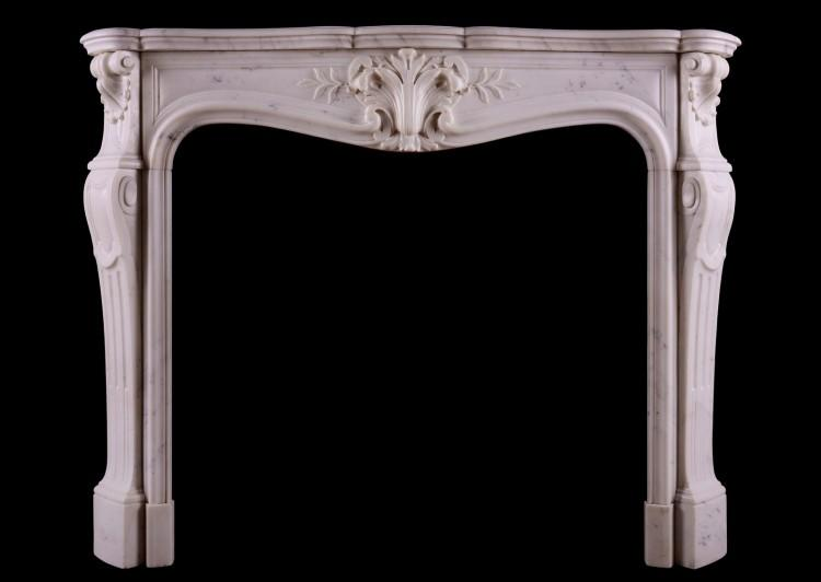 A Statuary marble fireplace in the Louis XV manner