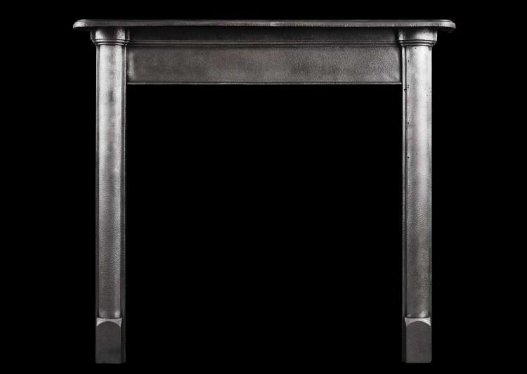 A simple polished cast iron fireplace