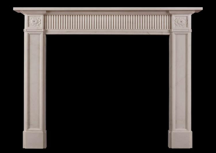 A late 18th century style white marble fireplace