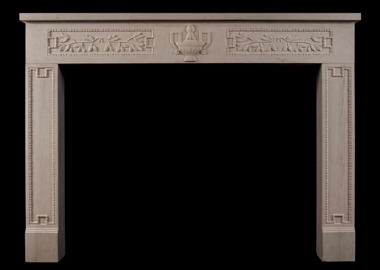 A rustic French limestone fireplace in the Louis XVI style