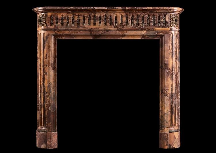 A petite Louis XVI style marble fireplace