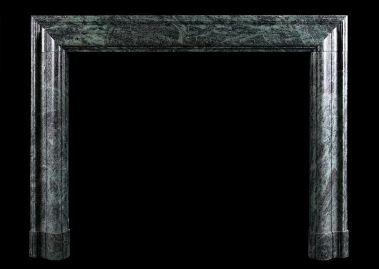 A Queen Anne style bolection fireplace in green marble