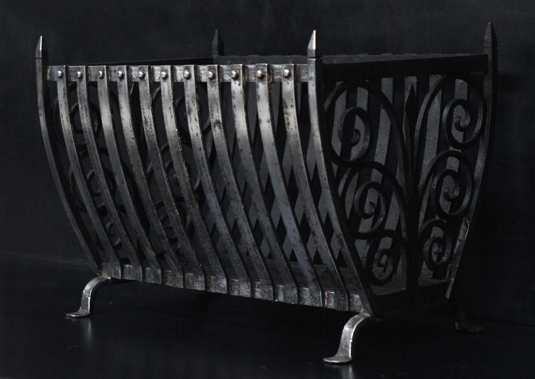 A polished wrought iron firebasket