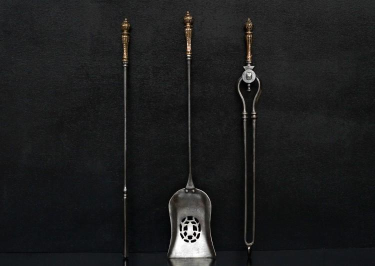 A set of brass and steel firetools 29.8 inch