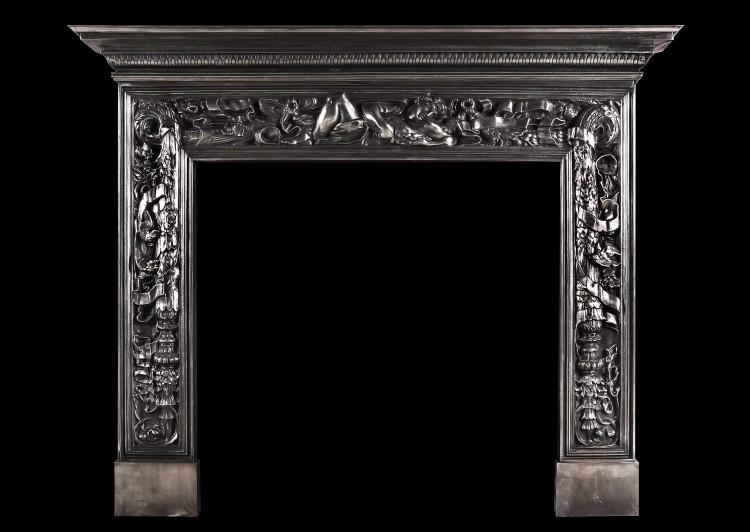 An ornate cast iron fireplace with reclining classical figure