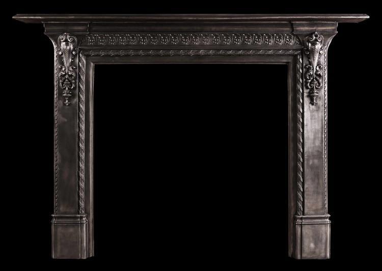 A mid 19th century English cast iron fireplace.