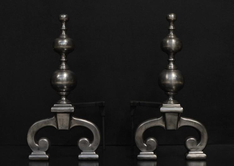 A pair of 19th century polished iron firedogs