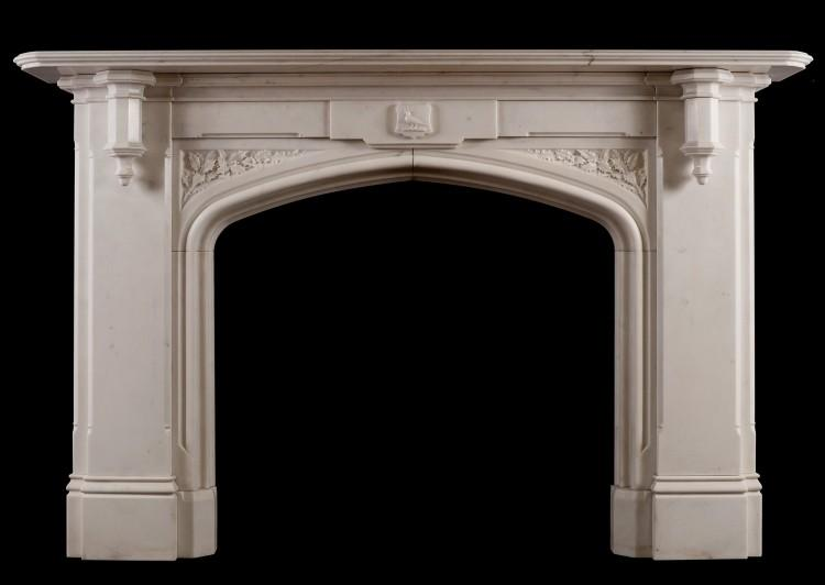 A fine Gothic Revivial Statuary marble fireplace