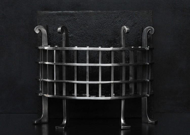 A half round English iron firegrate