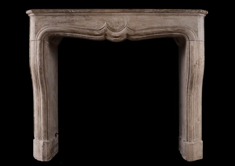 A rustic Louis XIV French fireplace