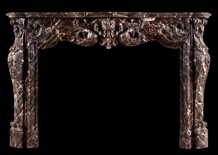 A sumptuous Emperador marble Louis XV style marble fireplace