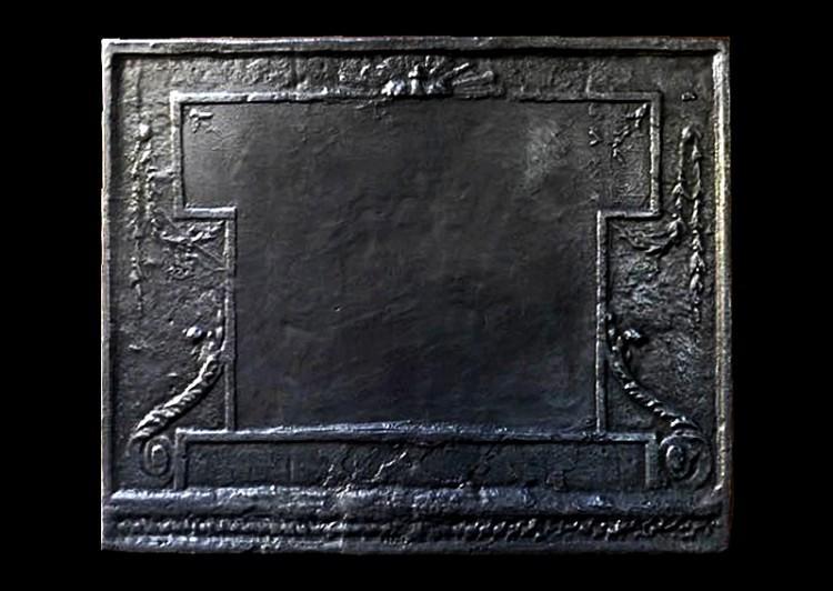 A large cast iron fireback