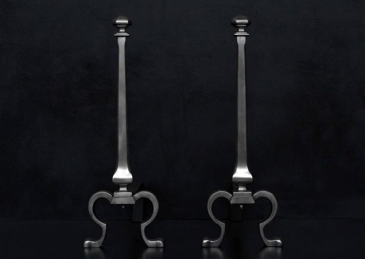 An elegant pair of steel firedogs