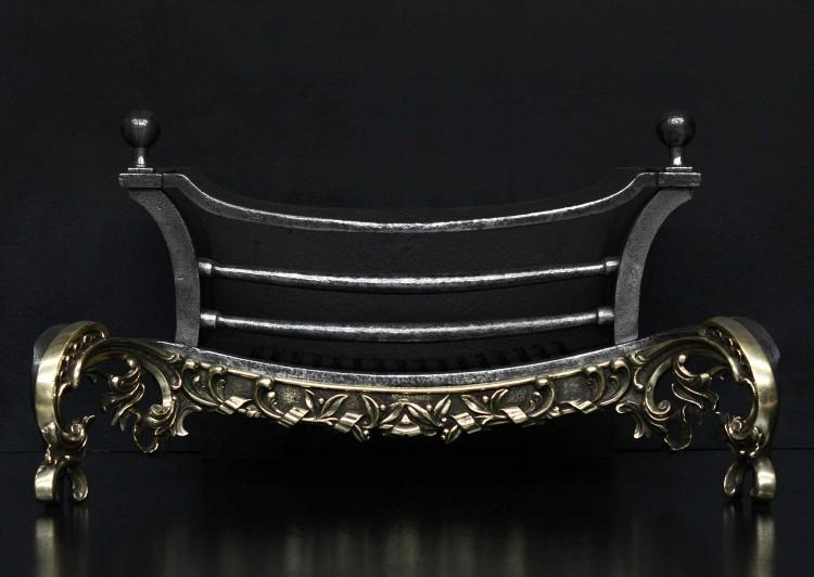 An attractive brass and iron firegrate in the Rococo taste