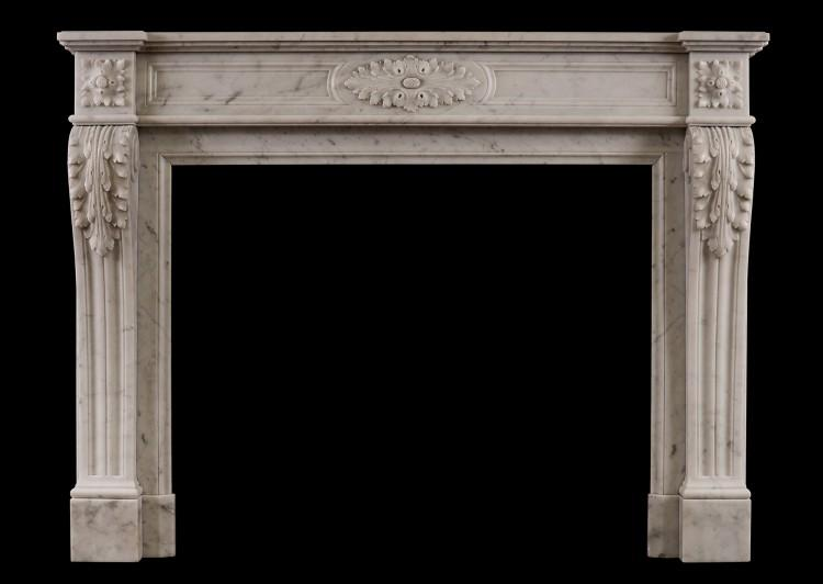 A French Carrara marble fireplace in the Louis XVI style
