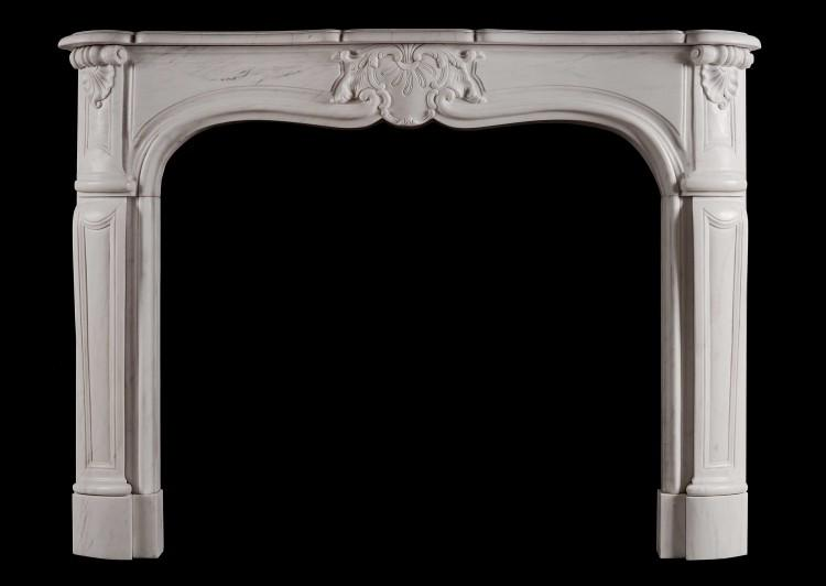 A French Louis XV style white marble fireplace