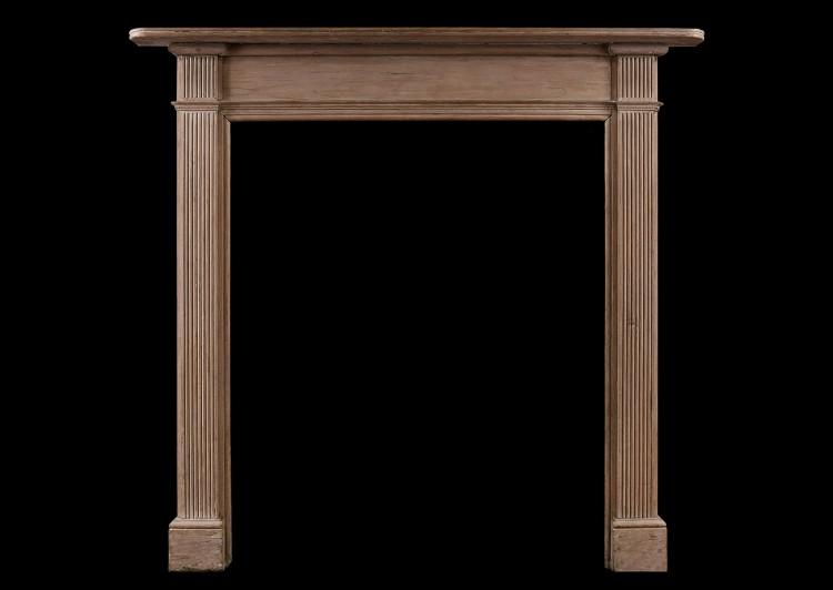 A late Georgian wood fireplace