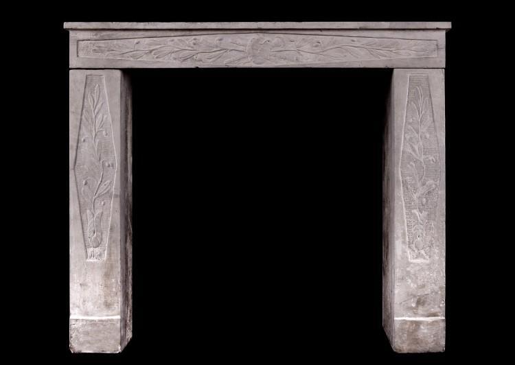 A petite Louis XVI stone fireplace