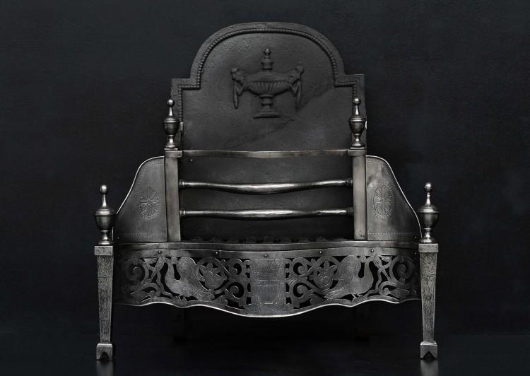 A Georgian style polished steel firebasket