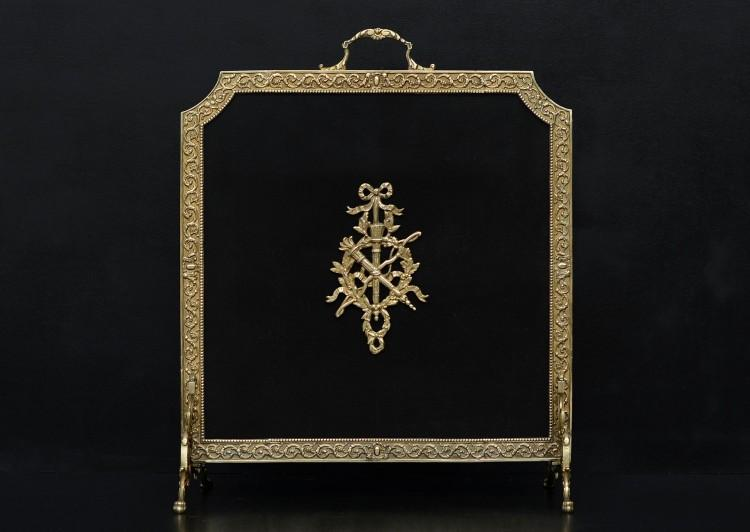 An ornate brass firescreen