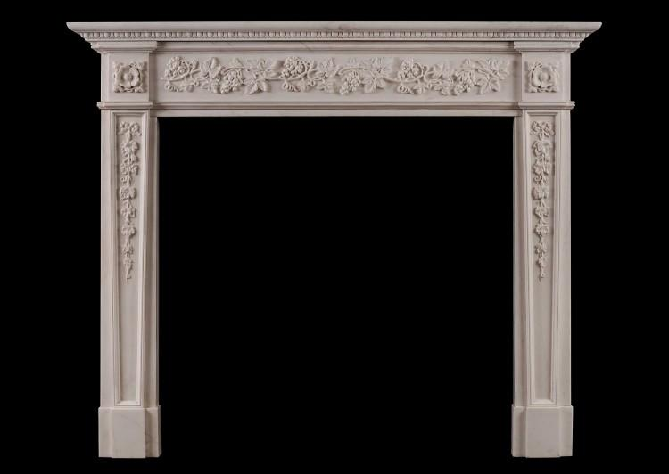 An English Regency style white marble fireplace
