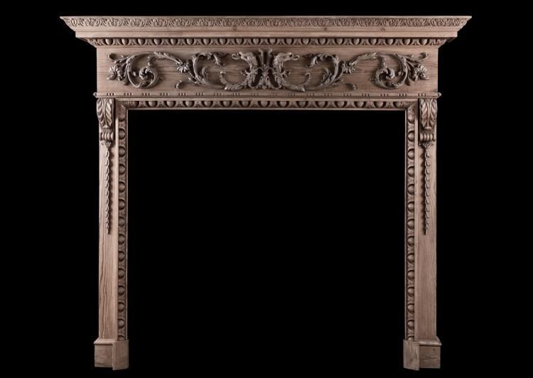 A fine quality carved pine fireplace