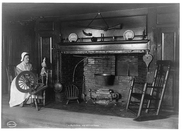 An American Puritan fireplace in a 1906 photograph, clearly showing the firedogs in situ. Photo: Library of Congress.