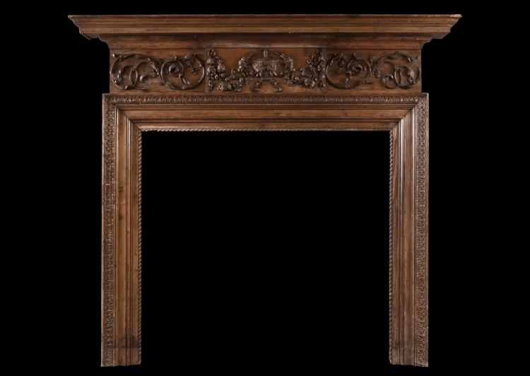 A carved English timber fireplace in the Georgian manner