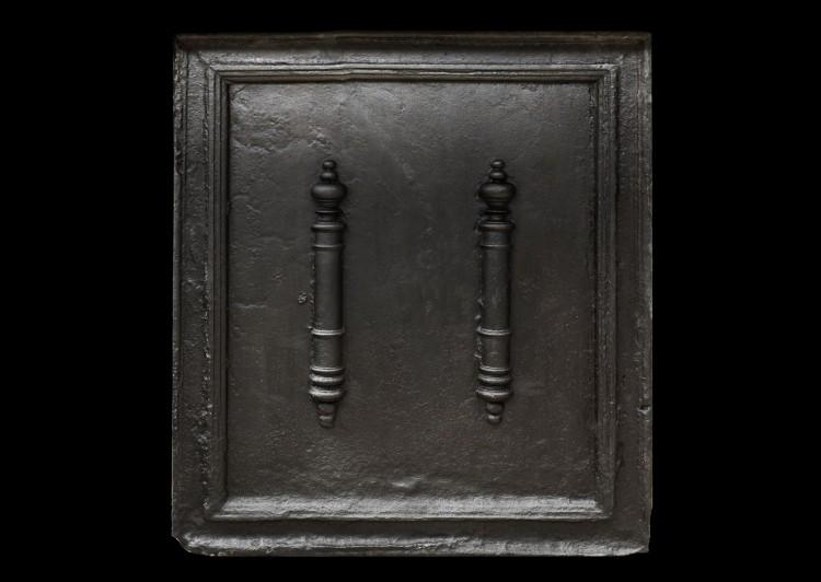 A substantial cast iron fireback