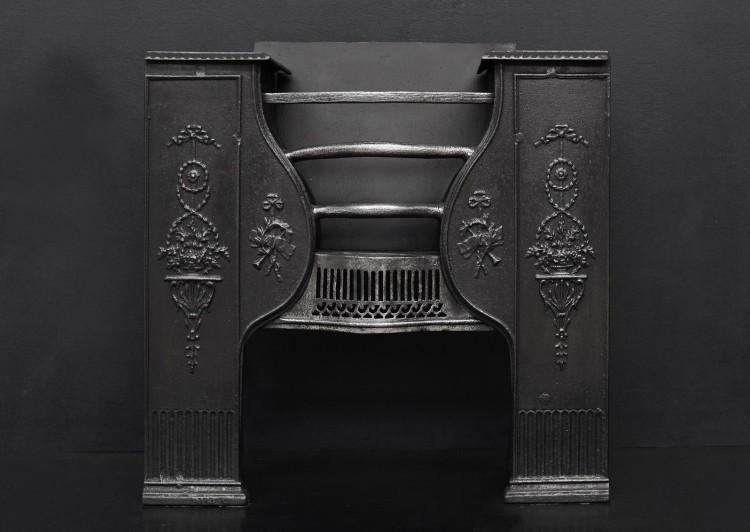 A Georgian style cast iron hob grate