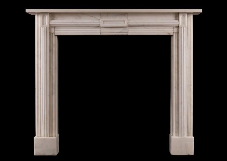 A Statuary marble fireplace in the Soanian style