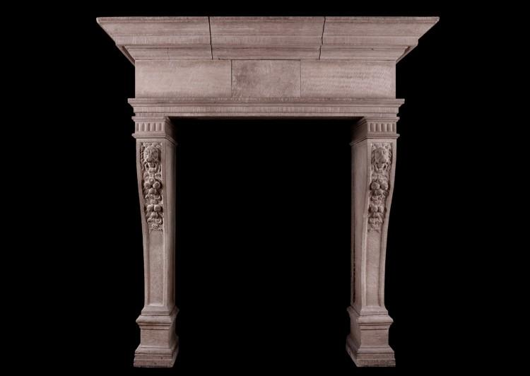 A rustic French limestone fireplace
