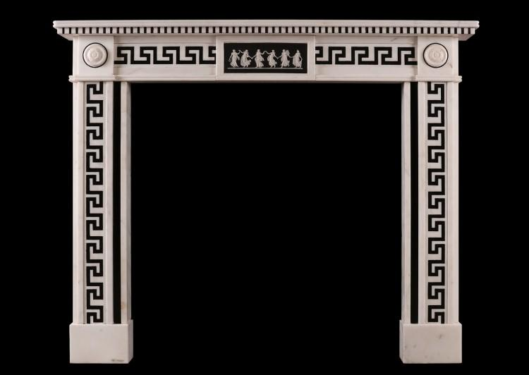 A Regency style white marble fireplace with black inlay