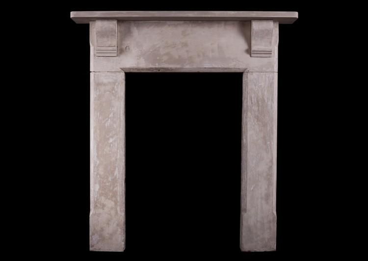 A shabby chic English stone fireplace