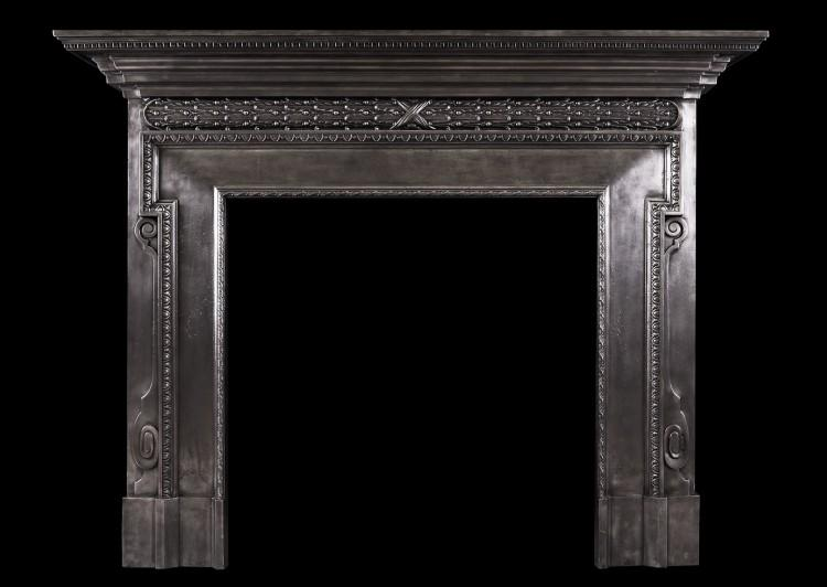 A polished cast iron fireplace in the mid Georgian style