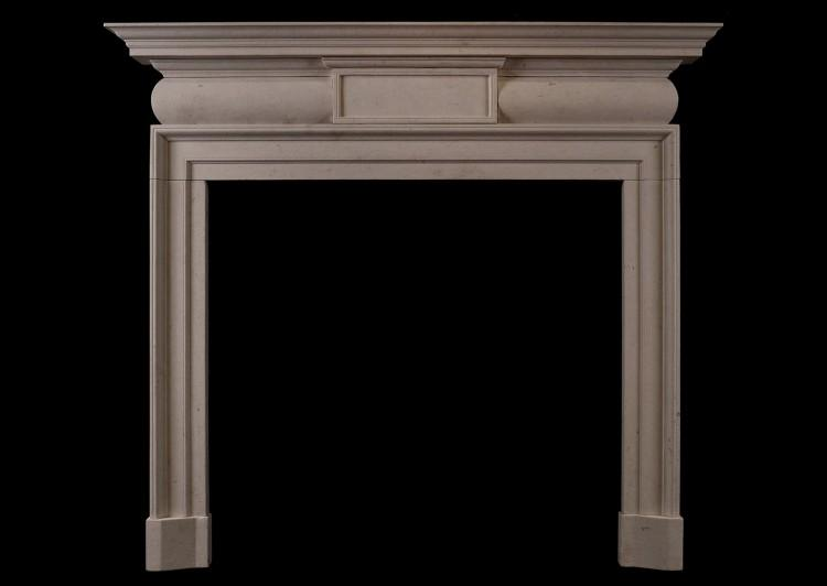 A Georgian Style limestone fireplace
