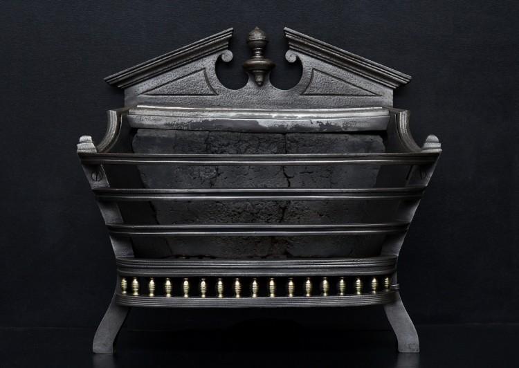 A Regency style cast iron firebasket