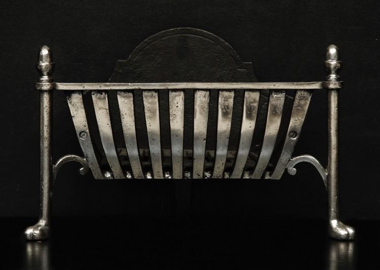 A stylish polished firebasket with an Art Deco influence