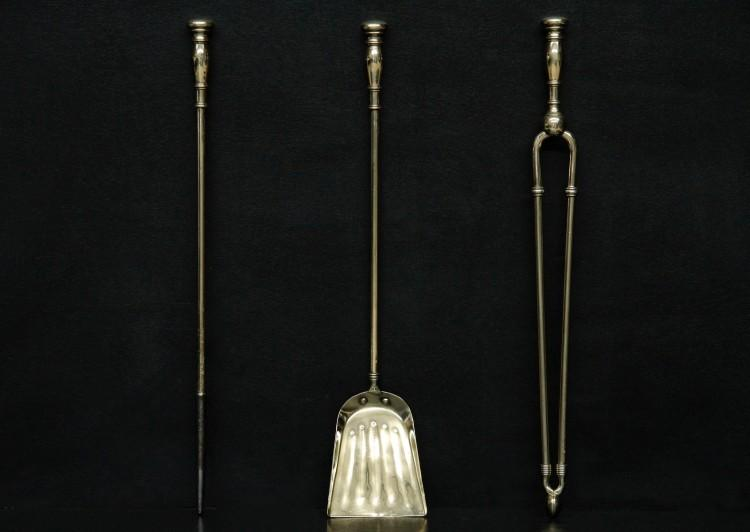 A simple set of brass firetools
