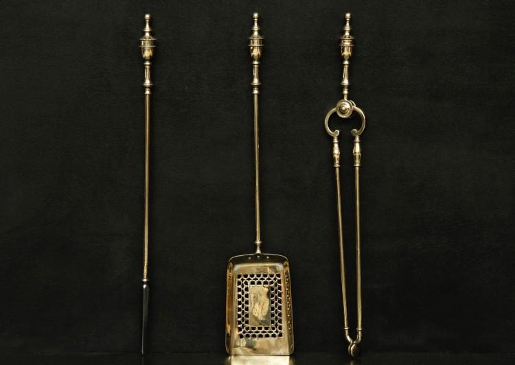A set of brass firetools in the Georgian manner