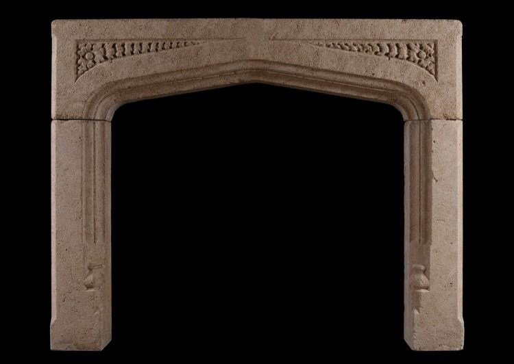 A Gothic Revival stone fireplace