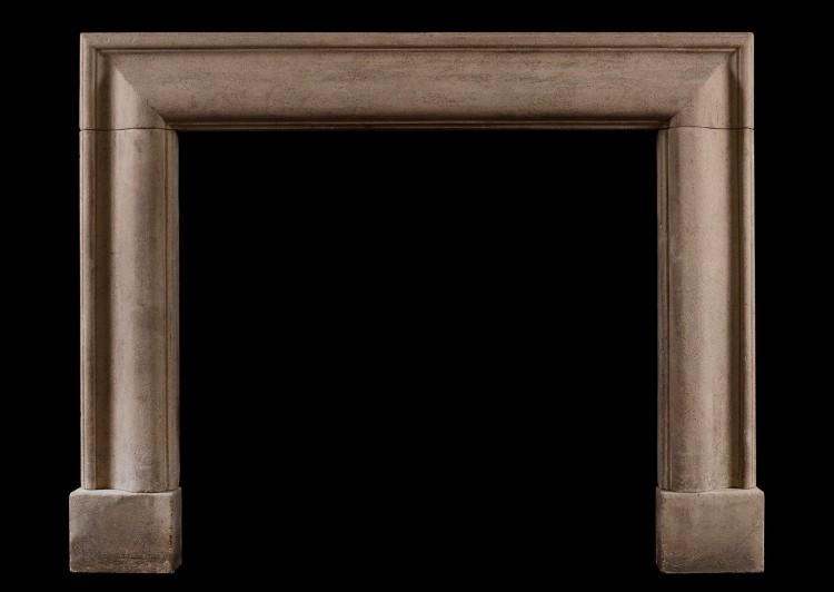 A Bath stone bolection fireplace.