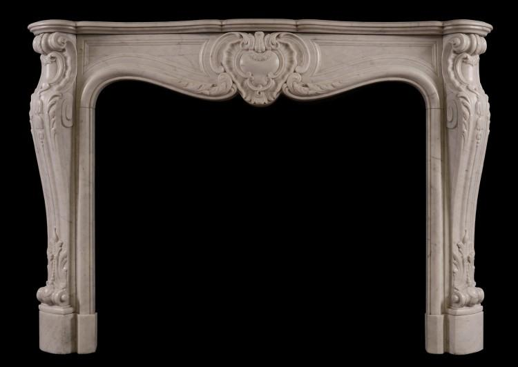 A French marble fireplace in the Louis XV style
